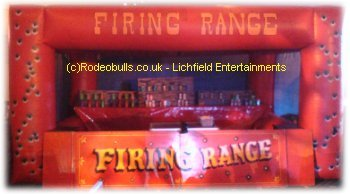 Inflatable Shooting Range. Safe cork firing rifles. How many cans, bottles, etc can you knock down? Bucking Sheep available for hire as an alternative to a Bucking Bronco