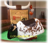 Rodeo bull with themed Wild West Inflatable